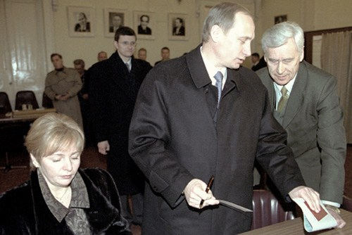 Putin casting his ballot for President, wife is dying
