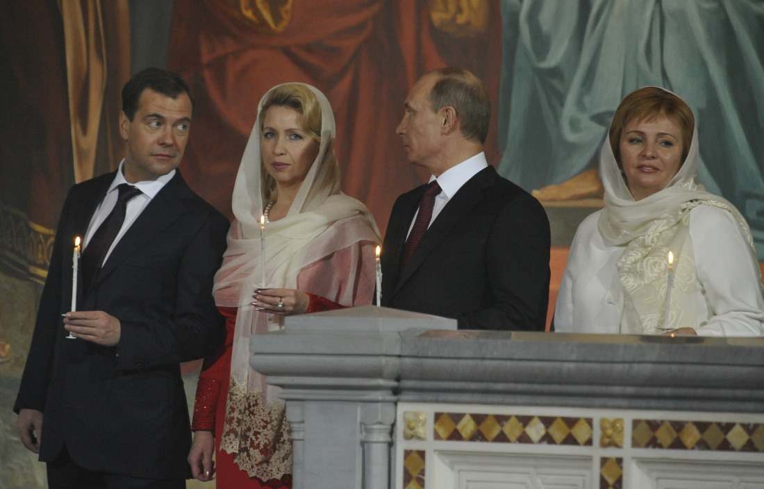 Russian President Medvedev and PM Putin attend an Orthodox Easter night service
